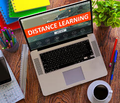Distance Learning on Laptop Screen. Online Working Concept.