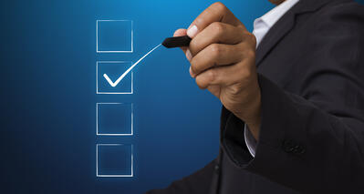business-man-with-pen-mark-the-checkbox