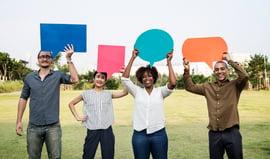 diverse-friends-holding-speech-bubbles