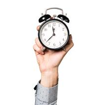 hand-of-man-holding-vintage-clock