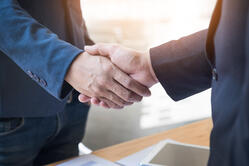 two-confident-business-man-shaking-hands-during-a-meeting-in-the-office-success-dealing-greeting-and-partner-concept
