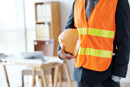 unrecognizable-male-construction-industry-executive-posing-safety-vest-with-hardhat