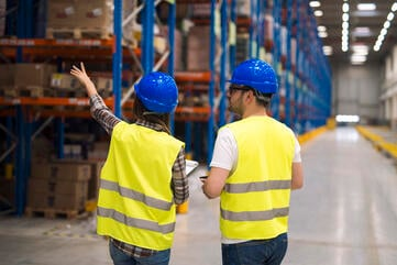 warehouse-workers-sharing-ideas-for-better-organization-and-efficiency