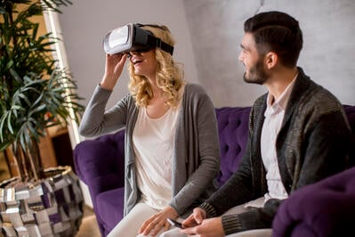 young-couple-sitting-in-the-room-while-young-woman-has-a-virtual-reality-glasses